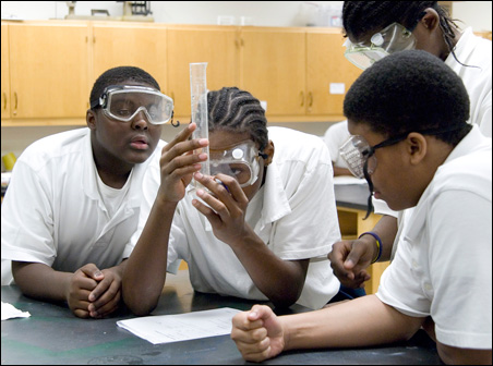 Middle-school science students work on an experiment at the Afrocentric Education Academy at Minneapolis' North High. From the left are Dashawn Williams, Wayland Johnson II, Elvis Stewart (in background) and Anthony Wallace.