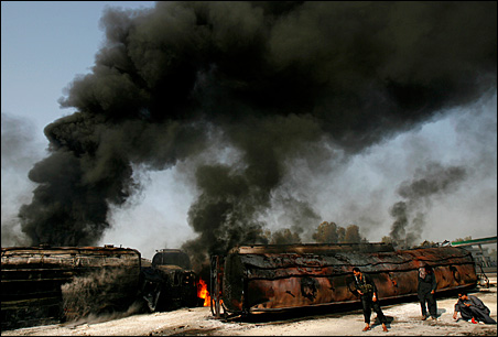 Suspected militants in Pakistan set fire to tankers carrying fuel for NATO troops in Afghanistan on Friday.