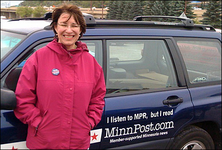 Sen. Amy Klobuchar standing in front of the MinnPost mobile HQ.