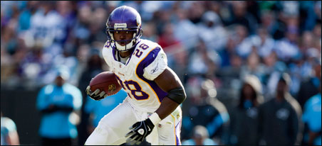 The rookie quarterback duel was exciting to watch, but in the end, the Vikings' victory depended on Adrian Peterson (above) and Percy Harvin.