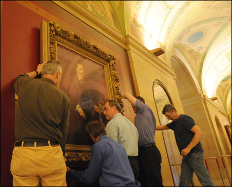 A portrait of William Merriam, Minnesota's eleventh governor, being re-hung in the state Capitol.