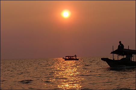 The sun setting on Cambodia's Tonle Sap lake.