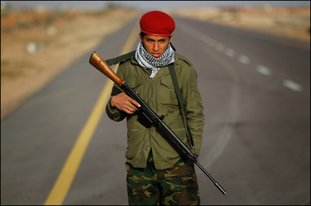 A rebel fighter guards the final checkpoint on the road from Bin Jawad towards Nawfiliyah.
