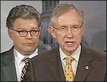 Sens. Al Franken and Harry Reid at Wednesday's news conference.