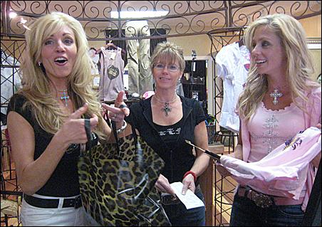 Kim Parmater Pederson, left, Debbie Slusar and Lisa Soldo-Johnson at their store.