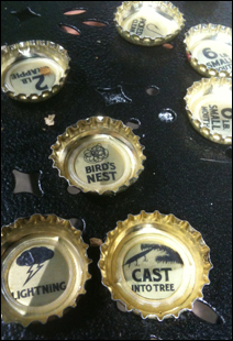Pocket Hercules's design for the beer includes fishing-themed notes under the bottlecaps.
