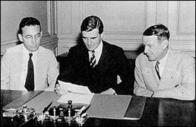 First meeting of the Social Security Board, September 14, 1935. Left to right: Arthur J. Altmeyer, John G. Winant (Chairman), and Vincent M. Miles.