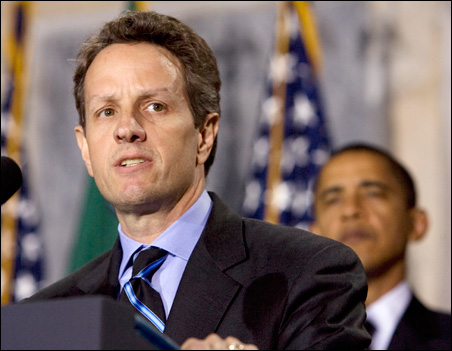 President Obama listens to Timothy Geithner after he is sworn in as U.S. Treasury Secretary.