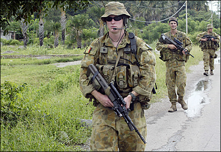 Australian troops patrol in Dili Tuesday, helping East Timor enforce its state of emergency.
