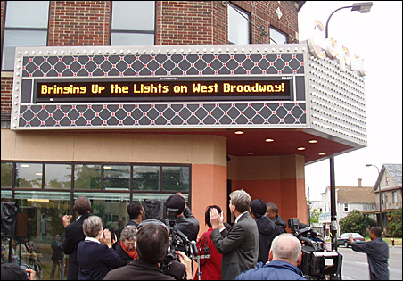 The retrofitted marquee was switched on at a press event in June 2009 with Mayor R.T. Rybak, center, and Councilman Don Samuels.
