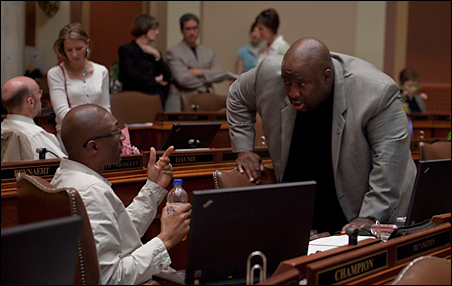 Reps. Bobby Joe Champion, left and Jeff Hayden, DFL first-termers from Minneapolis, confer during the last week of the legislative session.