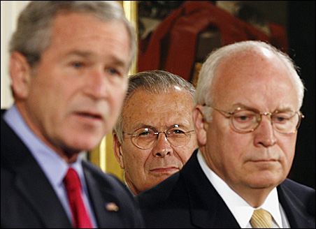 Then-Secretary of Defense Donald Rumsfeld, center, and Vice President Dick Cheney listen as President Bush speaks before signing the Military Commissions Act of 2006.