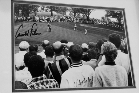 An autographed photo of Arnold Palmer putting on the 13th green (old 4th) hangs in the Keller Clubhouse.