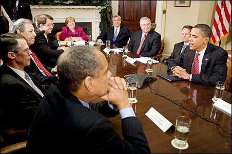 President Barack Obama, right, speaks to a speaker phone while meeting with financial services industry leaders in the Roosevelt Room of the White House on Monday.