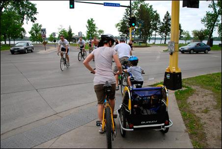 Cyclists approach Lake Calhoun in Minneapolis.