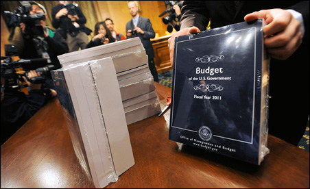 A Senate Budget Committee staff assistant stacks copies of the 2011 Budget for distribution to Senate staff on Monday.