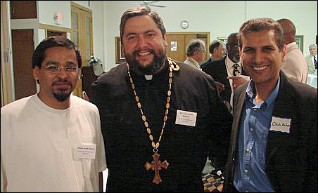 Imam Asad Zaman, the Rev. Fr. Marc Boulos, and Sheikh Odeh Muhawesh chatted during the Joshua DuBois reception.