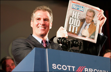 Republican U.S. Senator-elect Scott Brown holds up a copy of the Boston Herald announcing his victory on Tuesday.