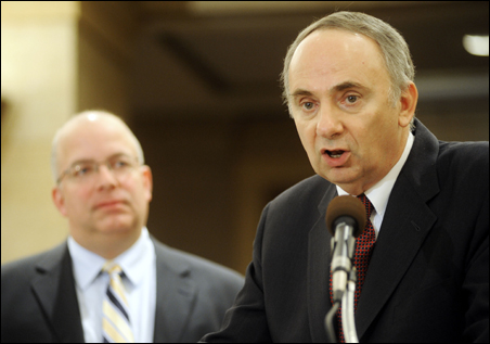State Economist Thomas Stinson (right) outlines Minnesota's economic troubles today as Tom Hanson, commissioner of Minnesota Management and Budget, looks on.