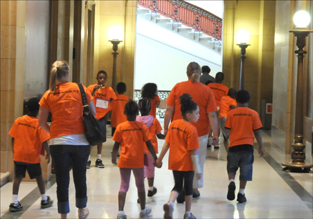 Kids from the Minneapolis YWCA tour the state Capitol.