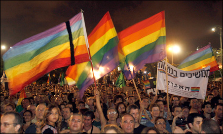 Israelis wave rainbow flags as they attend a rally against the recent shooting attack in Tel Aviv, August 8, 2009.