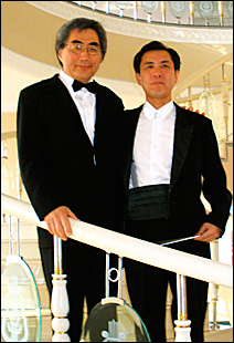Young-Nam Kim, left, with conductor Mun-Ho Choi in the lobby of the Main Concert Hall in PyongYang.