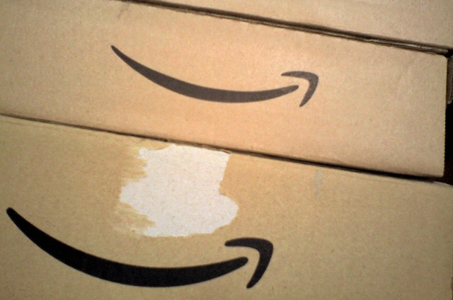 photo of cardboard boxes with amazon.com's logo