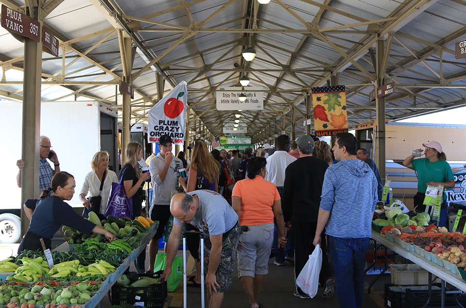 photo of shoppers in crowded farmers market
