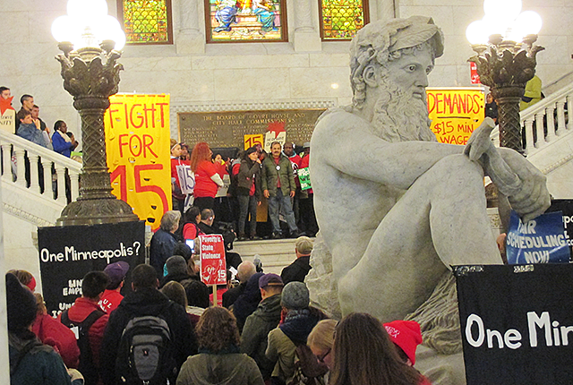 A large march for worker rights in City Hall on Tuesday