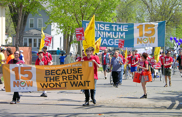 Members of the 15Now Minnesota organization in the May Day parade