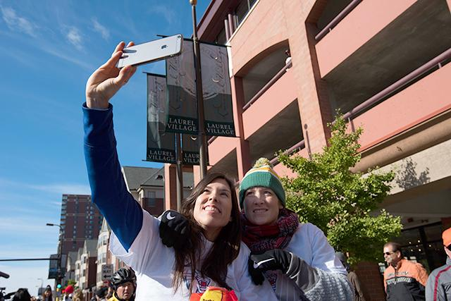 Guards Anna Cruz and Lindsay Whalen take a selfie mid-parade.