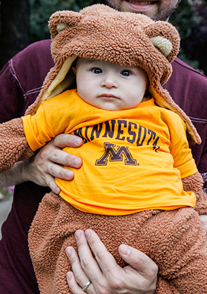 A HELP Center student's child wearing a Goldy Gopher costume.