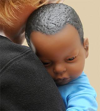 Infant simulator doll