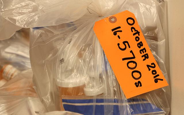 A bag containing prescription pill bottles