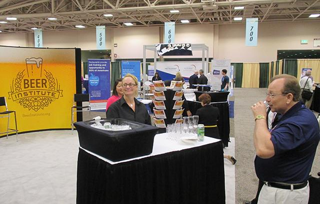 Attendees sampling the brew at the Beer Institute booth.