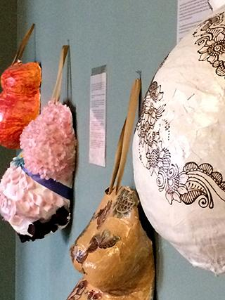 Casts of pregnant bellies decorate the walls