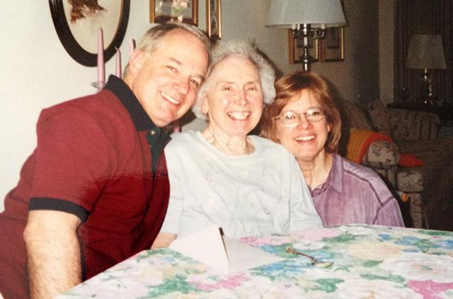 Carol Koskinen, right, with her mother and brother in 2001.