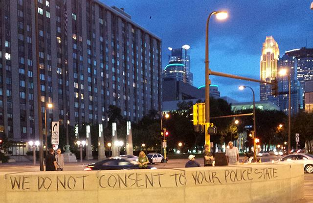 "On Aug. 19, OccupyMN held a ""Chalk the Police State"" protest"