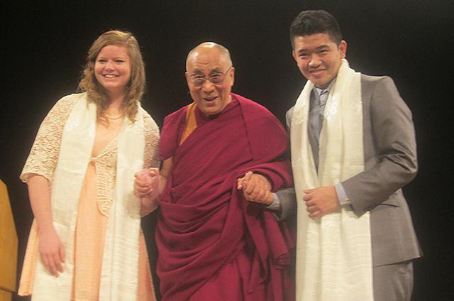 The Dalai Lama with two Augsburg College students