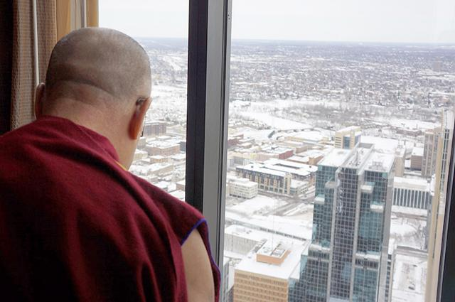 The Dalai Lama considers the nine-below-zero Minneapolis skyline