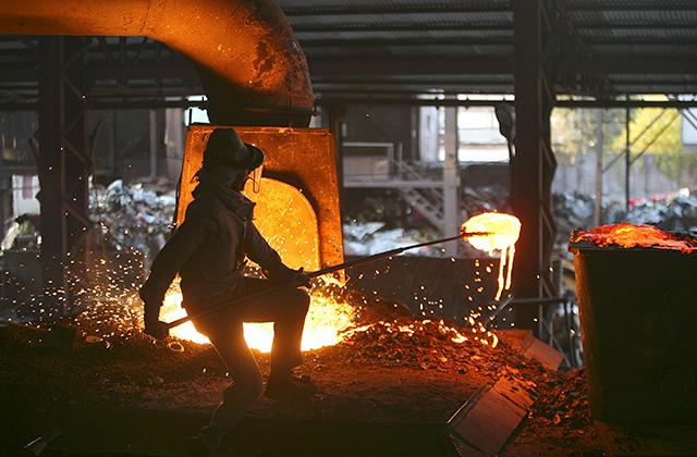 A labourer works inside a steel factory on the outskirts of Jammu, India.