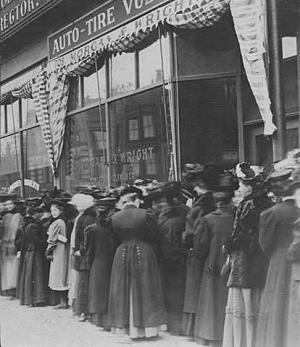 Minneapolis women lining up to vote for the first time in a presidential electio