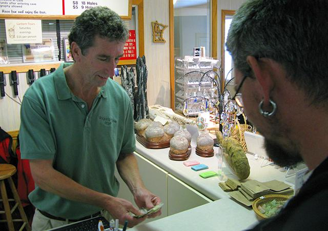 Mark Bishop, proprietor of Niagara Cave, works behind the counter