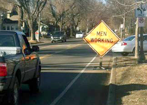 "A ""men working"" sign blocking a bike lane on Fairview Ave. in St. Paul."