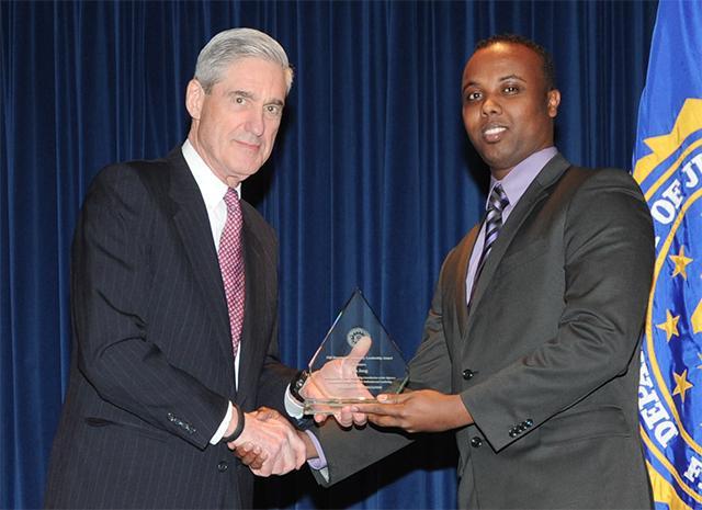 FBI Director Robert Mueller and Ka Joog Executive Director Mohamed Farah