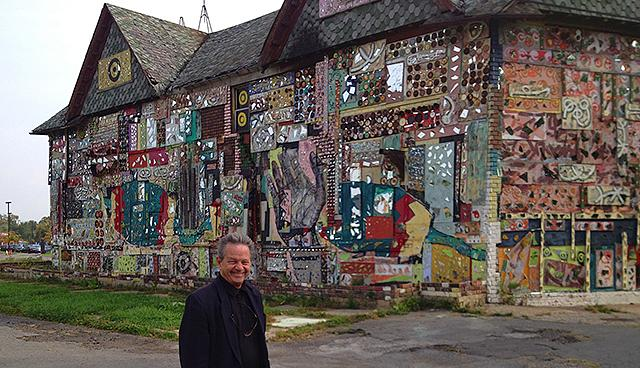 Photojournalist Bruce Giffin posing in front of the N'Kisi Iron House.