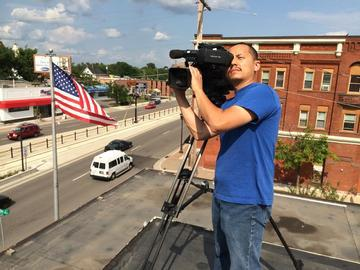 """Noel Lee shoots for """"Hmong Pioneers"""" project on University Avenue."""