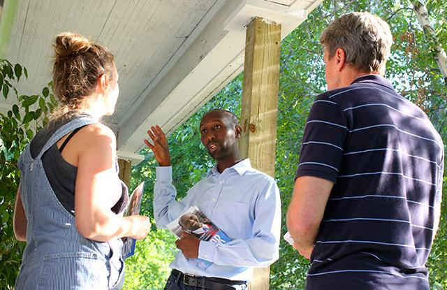 Mohamud Noor, center, door knocking in Seward with R.T. Rybak.