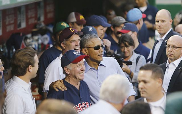 President Barack Obama posing for photographs in the dugout