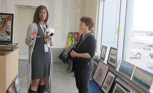 Robyne Robinson showing Lucinda Winter the airport's screening room